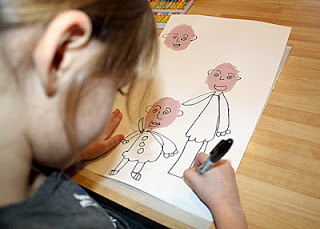 ...and body parts. She thought about how to layer each family member as she drew.