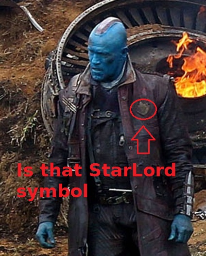 Star lord s traditional symbol emblazoned upon his trench coat