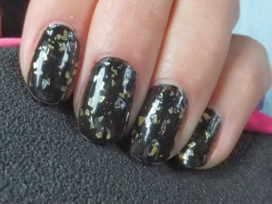 Black and gold leaf nails