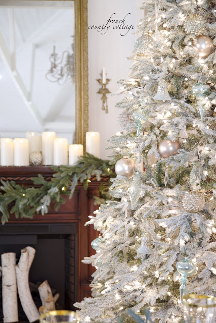 Frosted Christmas tree with shabby ornaments