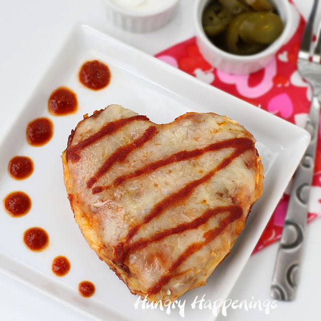 Spice up your Valentine's Day by serving Chicken Enchilada Hearts. Recipe from HungryHappenings.com