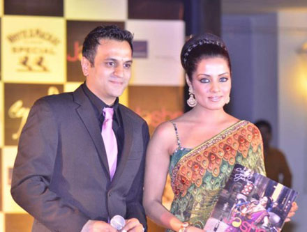 Celina Jaitley in Backless Green Saari at Launching Jashns Calendar navel show