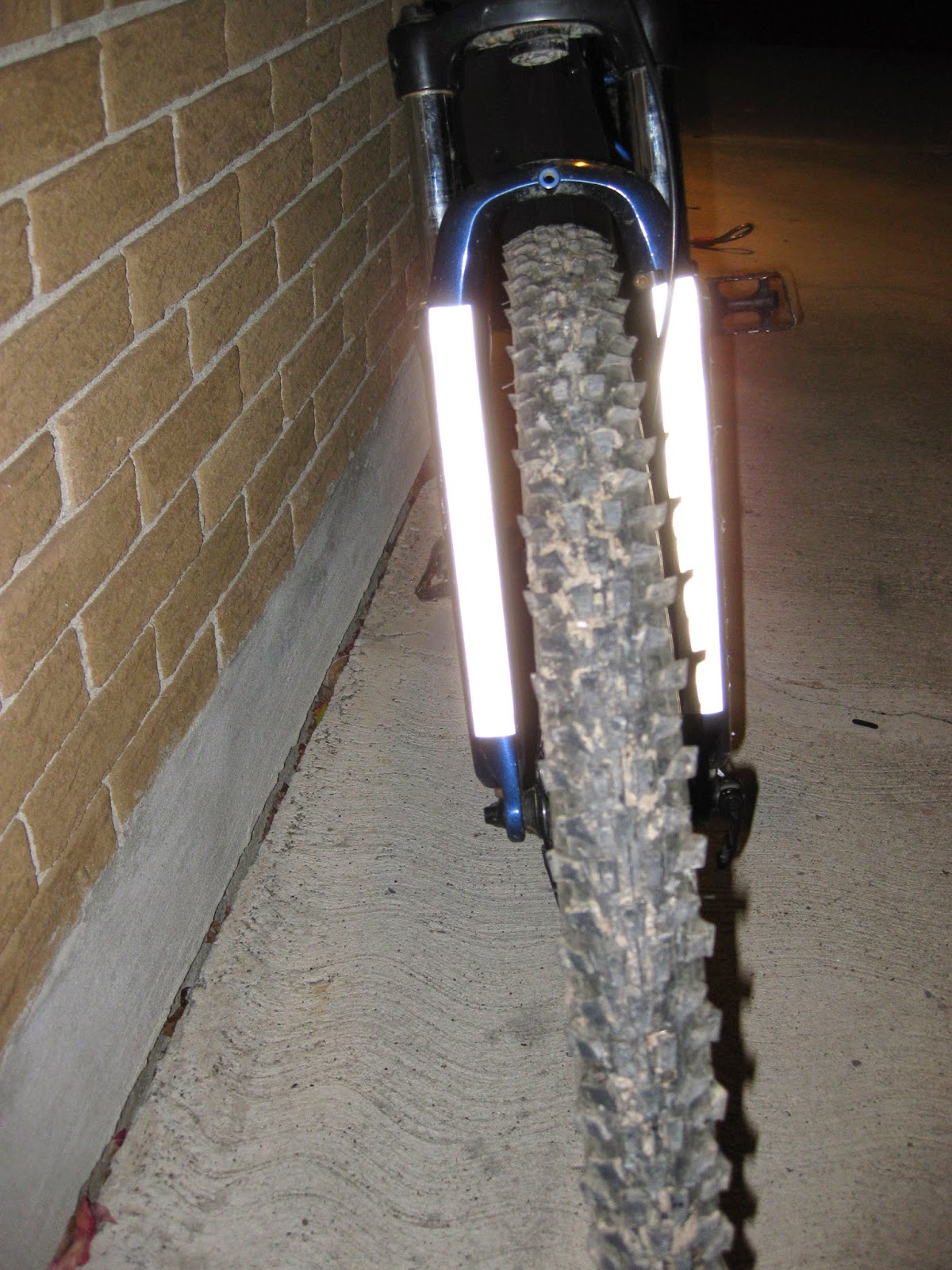 Front fork with reflective white surface.