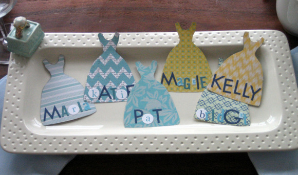 Different place cards featuring various dress designs add character to this themed brunch.