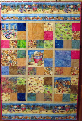 comfy couch quilt representing a fun day at the beach