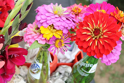 cut flower arrangement in soda pop bottles