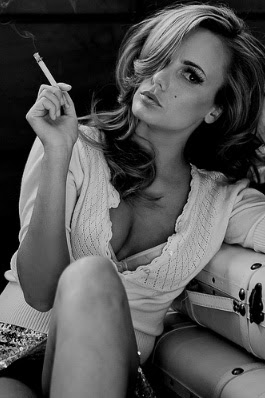 Sexy and elegant woman smoking