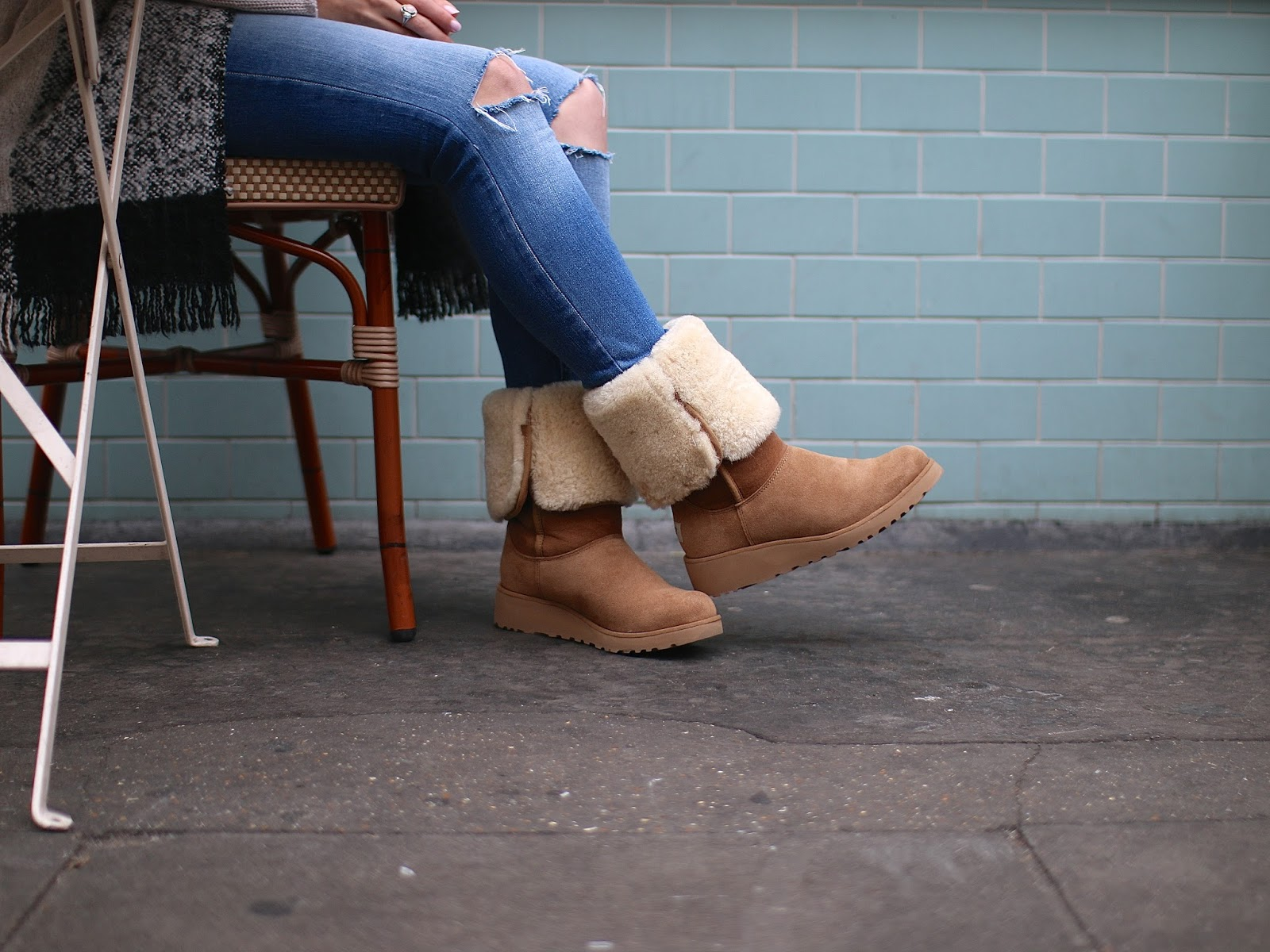 warm and fuzzy ugg boots are perfect for walking around london in the fall
