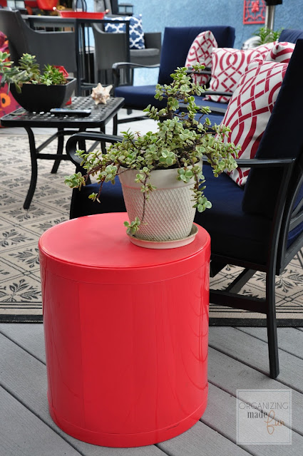 Red Otto Storage Stool on patio :: OrganizingMadeFun.com