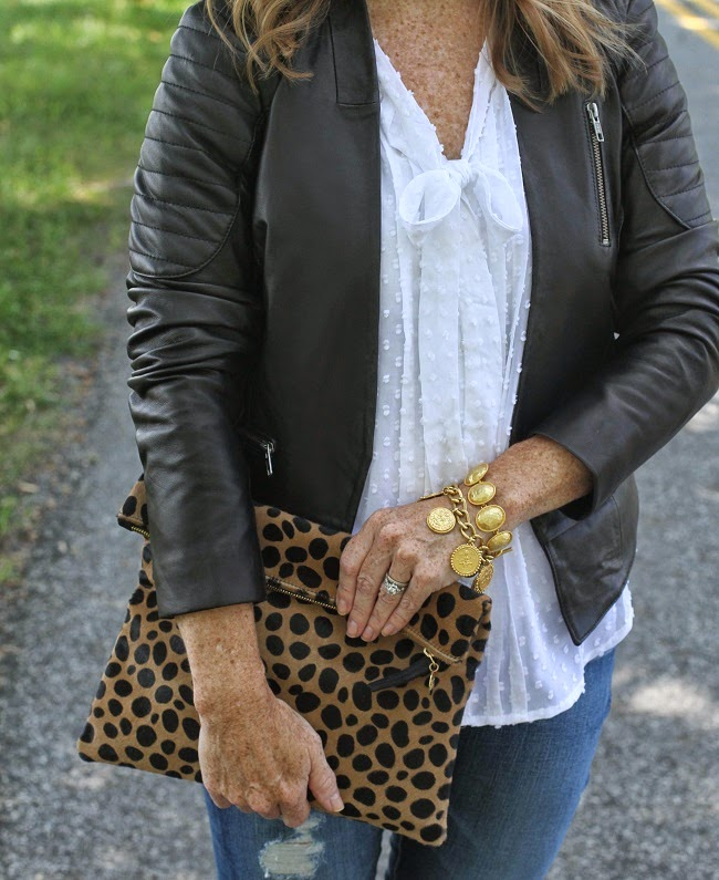 halogen leather jacket, loft swiss dot blouse, clare vivier clutch, julie vos necklace
