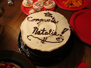 Red Velvet cake with cream cheese icing and the words Congrats Natalie on top