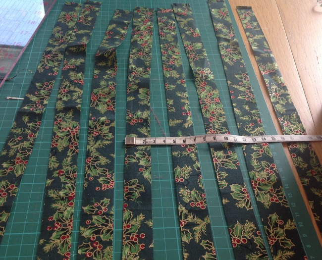 picture of 8 strips of dark green fabric