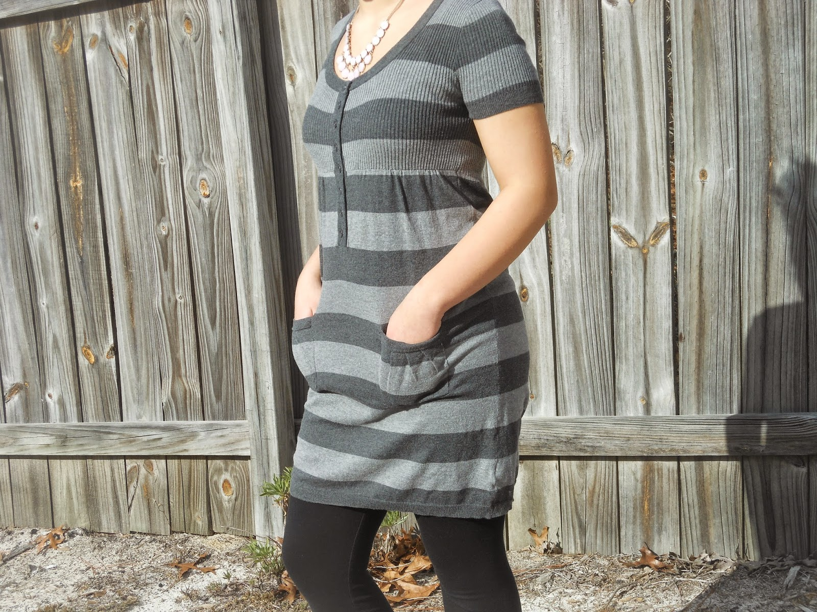How to Wear a Dress in Winter || 05. Grey sweater dress, black leggings, black ankle boots, statement necklace.