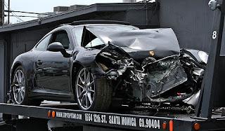 Car Crash: Lindsay Lohan Wrecks Rented Porsche  911
