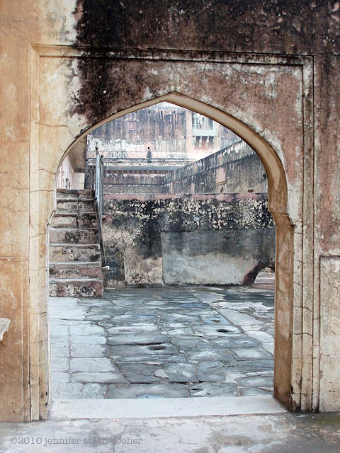 archway, mottled stone, lichen, patina