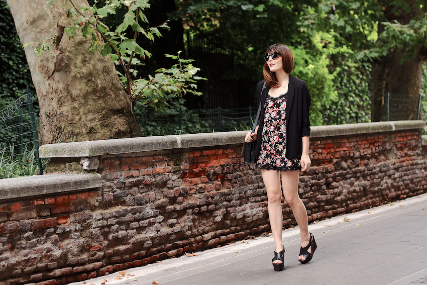 A summer city look featuring a printed playsuit with lace details, wedges and a black chic blazer. irene buffa milan