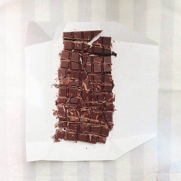 chocolate bar in squares, on gray stripes