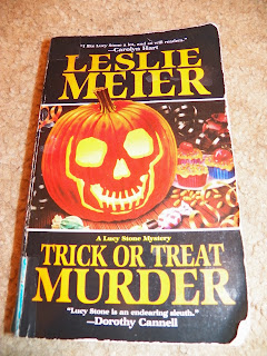 http://www.amazon.com/Trick-Treat-Murder-Stone-Mysteries/dp/1575662191