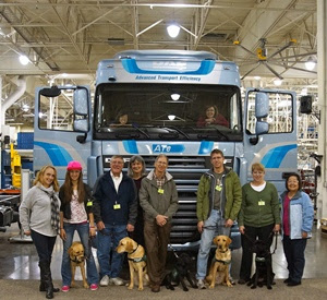 Paws for Independence puppies-in-training tour the Kenworth Renton truck plant in WA.