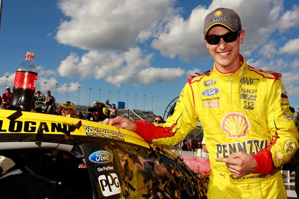 Joey Logano, driver of the #22 Shell-Pennzoil Ford, celebrates in Victory Lane the #NASCAR Sprint Cup Series Hollywood Casino 400