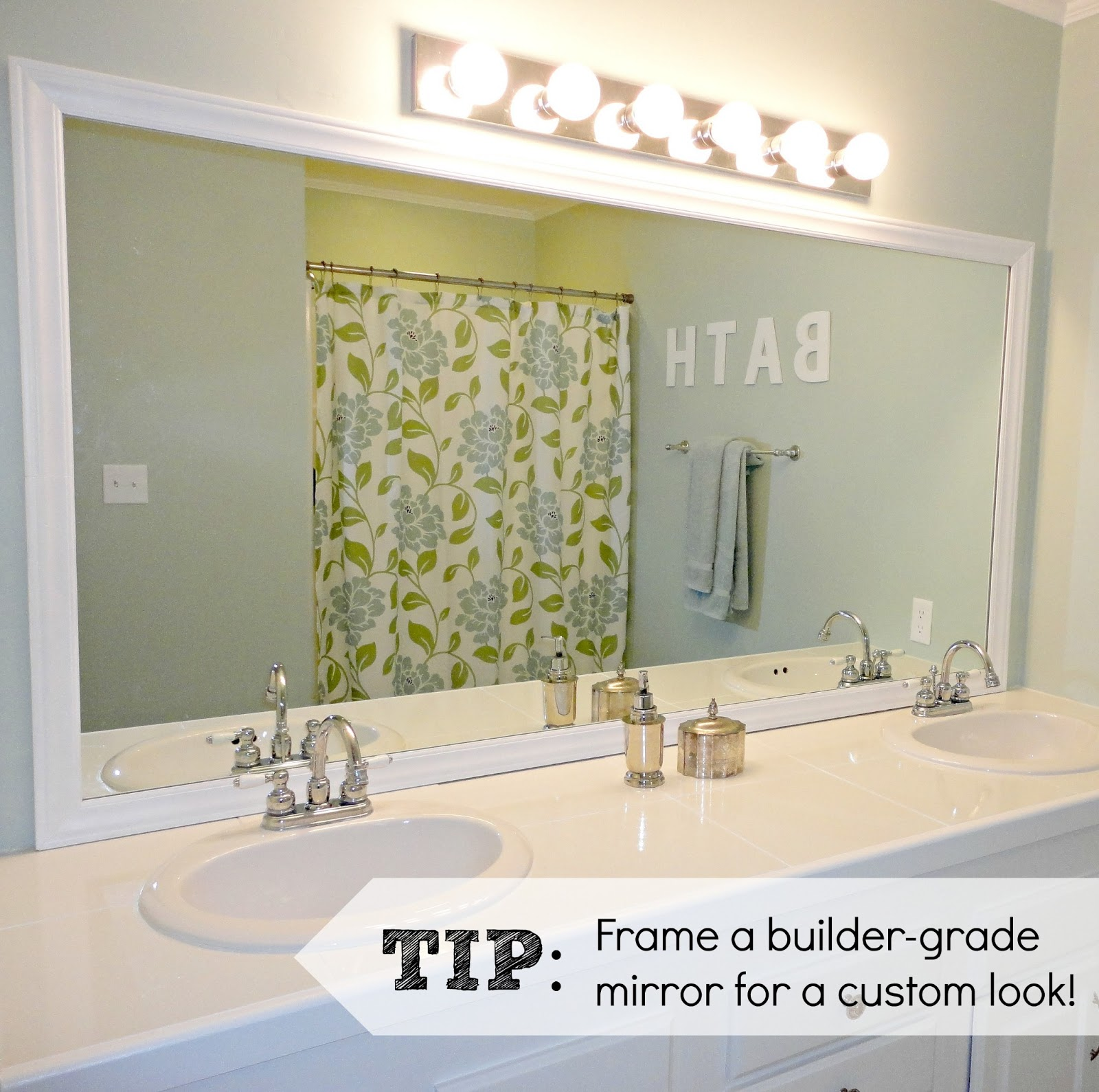 Livelovediy easy diy ideas for updating your bathroom here is the finished mirror all framed in after we glued the frame to the mirror i caulked the gaps and painted the entire frame white amipublicfo Images