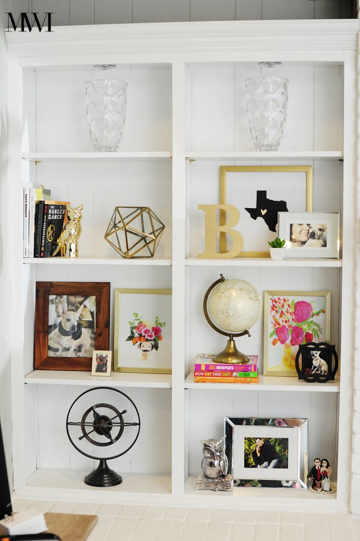 Give your bookcases/shelves a high end look by lining them with black wallpaper! It really helps accessories pop. via monicawantsit.com