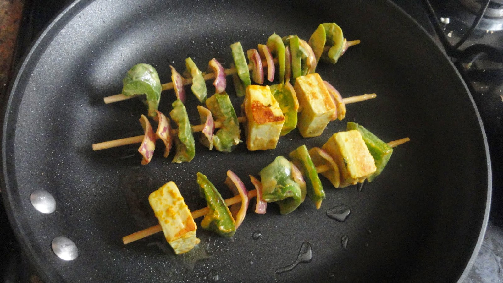 Place the skewers in pan with oil