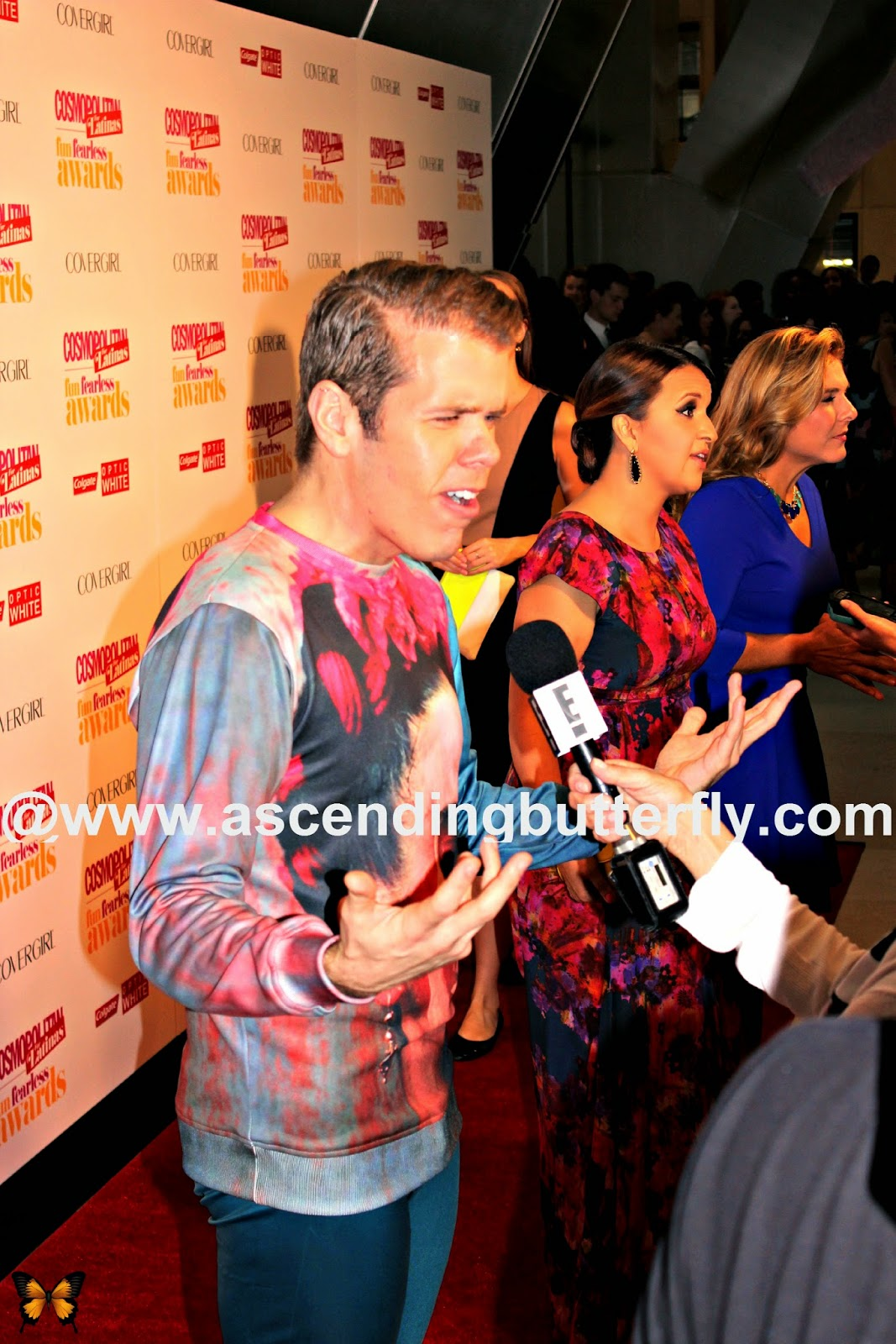 Blogger Perez Hilton gets interviewed on the red carpet at Cosmopolitan for Latinas Fun Fearless Awards 2014 in New York City