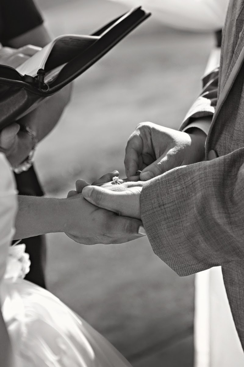 Nate places Molly's wedding ring her hand - Patricia Stimac, Seattle Wedding Officiant