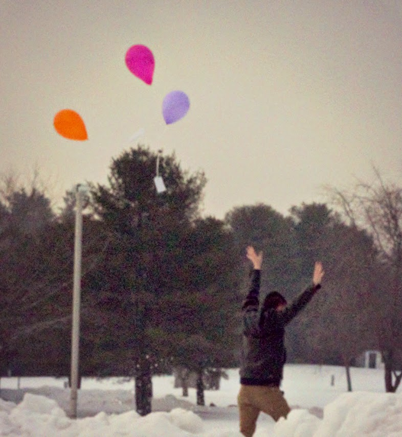 "A student releases balloons in rememberence of ""Ode to the West Wind,"" by Percy Shelley."