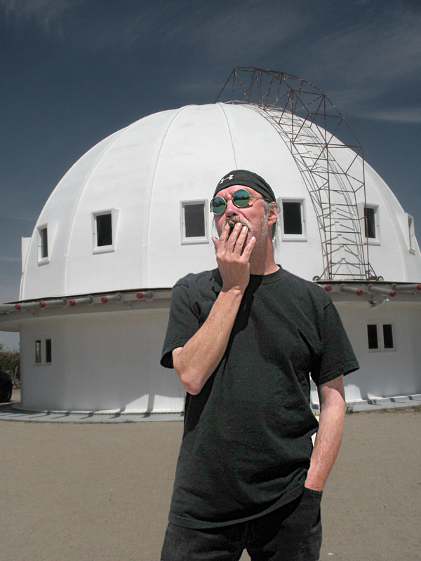 Art Jarvinen smoking a cigar at the Integratron