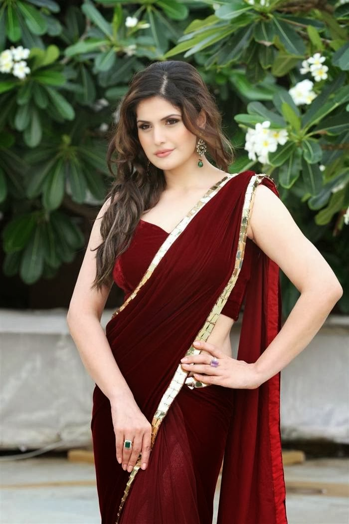Zarine Khan in Red Saree with Sleeveless Backless Maroon Velvet Blouse Pics New Photos