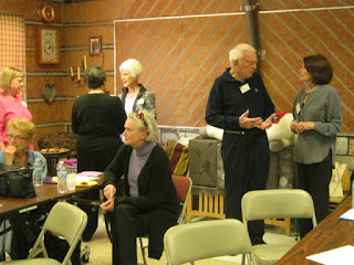 Several Friends socializing at the meeting