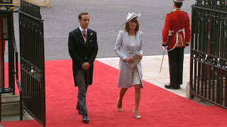 Carol and James Middleton, Kate's mother and brother, arrive at Westminster Abbey. Carol is wearing a dress by designer Catherine Walker.