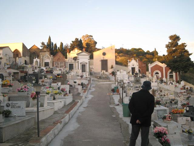 An old man studying the graveyard in Castiglione della Pescaia