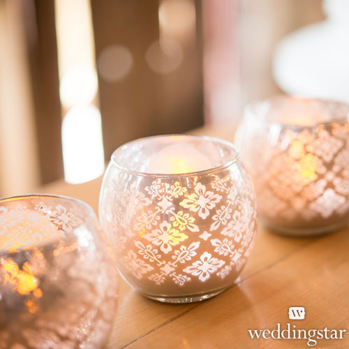 http://www.weddingfavoursaustralia.com.au/products/small-glass-globe-votive-candle-holders-with-reflective-lace-pattern-set-of-6