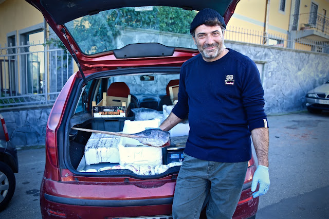 fish seller, back of car,  catania, sicily
