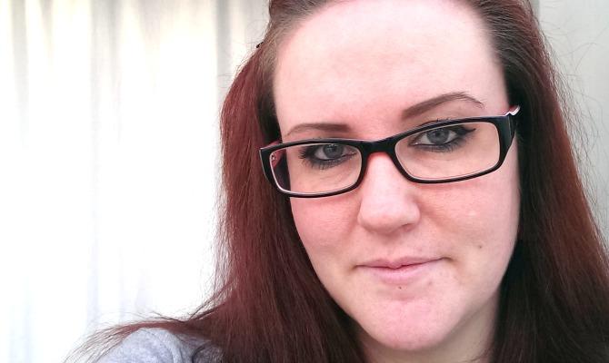 Me wearing black & orange glasses