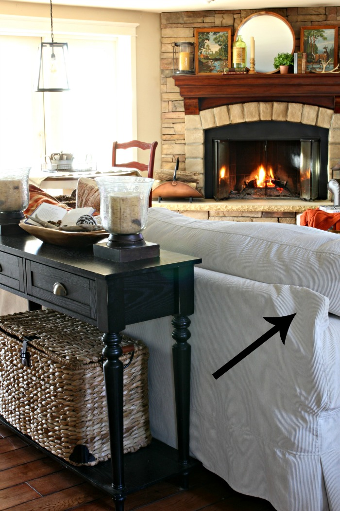 Rustic corner stone fireplace in family room with eclectic mantel decor - www.goldenboysandme.com