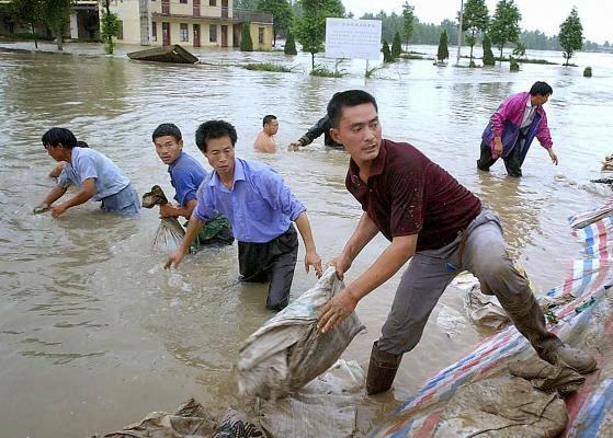 12 MUERTOS Y CASI 3 MILLONES DE AFECTADOS POR INUNDACIONES EN CHINA, 21 de Junio 2014