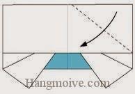 Bước 6: Gấp chéo góc của lớp giấy trên cùng xuống phía dưới.