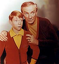 Dr. Smith and Will looking fearful in Lost In Space 1965 movieloversreviews.blogspot.com