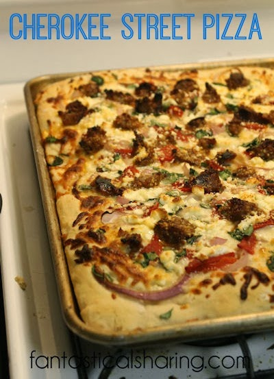 Cherokee Street Pizza | This pizza is just bursting with different flavors from spicy sausage to tart feta cheese!