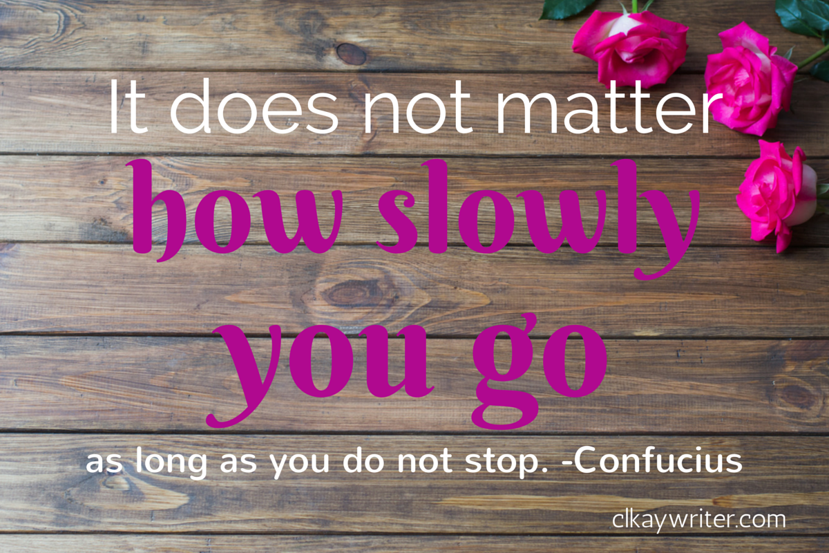 roses laying on wood table with confucius quote overlay