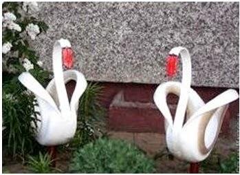 A mi manera cisnes hechos con llantas de carro for Como hacer adornos para el jardin