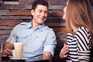 How Do You Know When She's Attracted To You - couple-flirting-at-coffee-shop