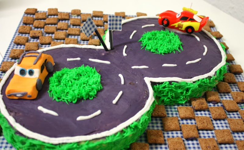 Race Track cake with Lightening McQeens and Cars Toppers