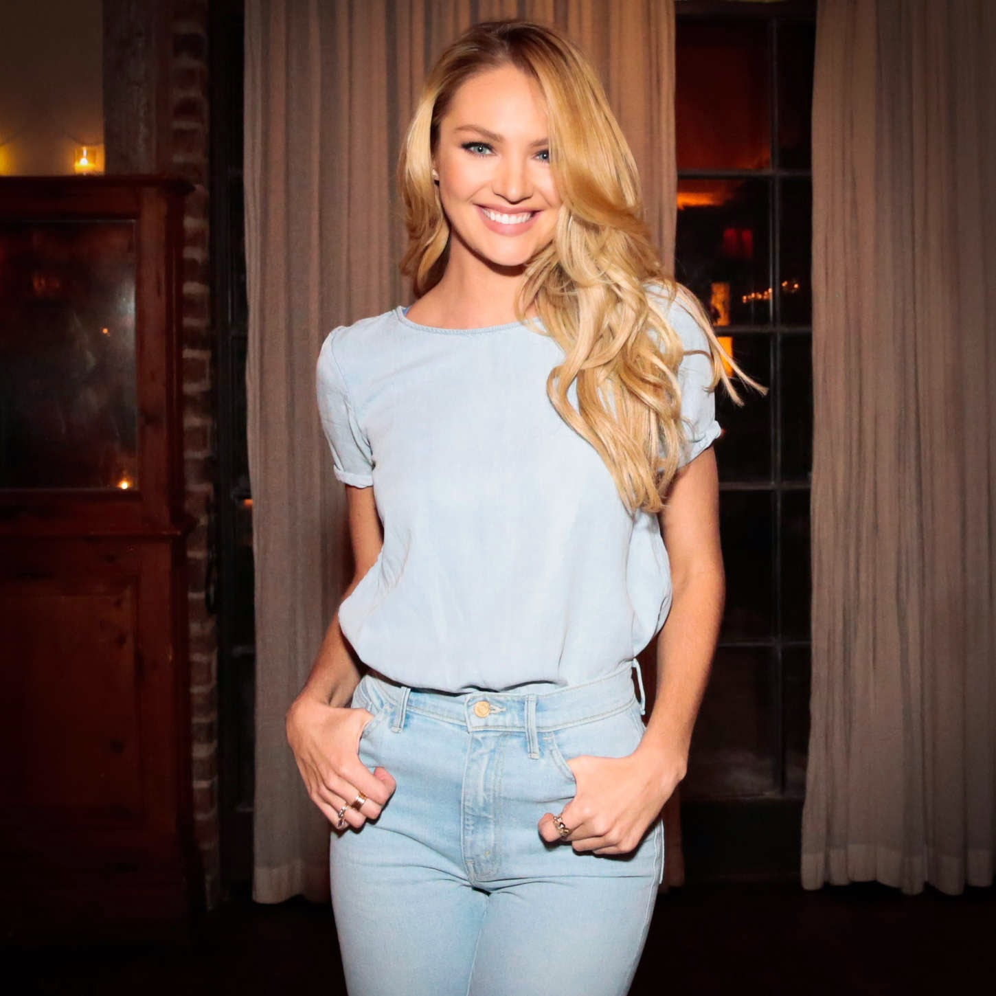 Candice Swanepoel shows off curves in denim jeans at the Mother Denim collaboration event in NYC