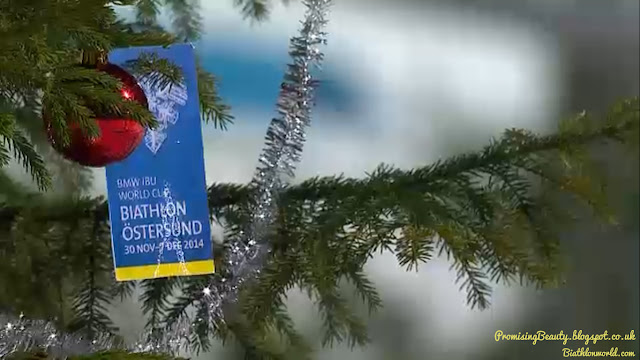 Biathlon at ostersund, Sweden in 2014. A fur tree or pine tree with christmas baubles and tinsel in the snow. Wintersport shown on eurosport and biathlonworld.com.