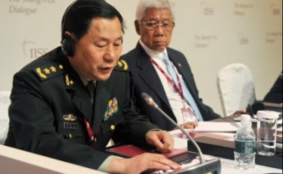 Lt. Gen. Qi Jianguo tests the microphone as Philippine Defense Secretary Voltaire Gazmin watches at the Shangri-la Dialogue in Singapore. AFP PHOTO